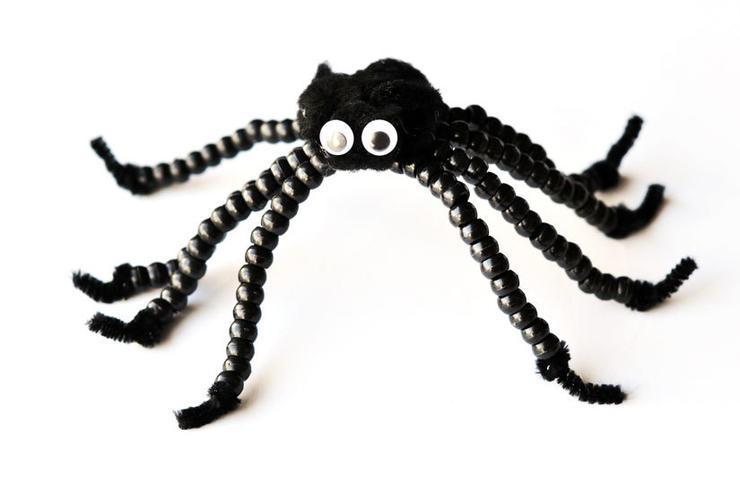 Some pipe cleaners, a black pompom, googly eyes, and pony beads are all it takes to make this sweet and cuddly beaded Halloween spider. Perfect for a low-mess craft to do together before heading out for an afternoon of errands (plus this way there's a new friend to take along for the ride).