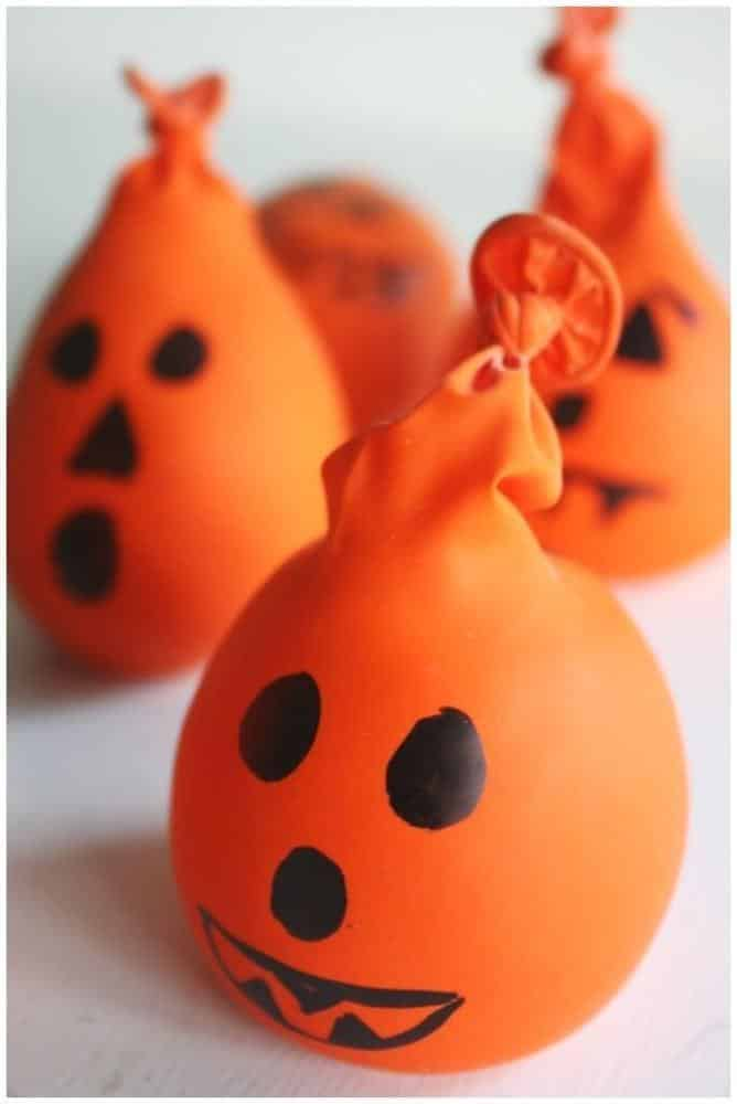 The awesome thing about these pumpkin stress balls is that they can be filled with any small sensory item that's hanging around: rice, unpopped popcorn kernels, buttons, playdough, small beads. They're great for handing to kids who need a little help calming down (or for when mom or dad can use a little help finding their inner Zen).